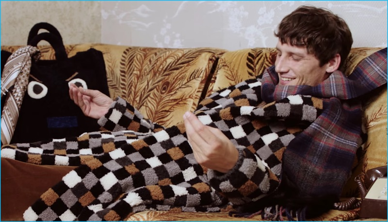 Roch Barbot lounges in a statement check coat from Fendi's fall-winter 2016 collection.