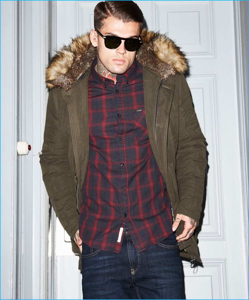 Stephen James is a cool vision in an Autark parka with a Lee plaid button-down shirt for Theo Wormland's fall-winter 2016 campaign.