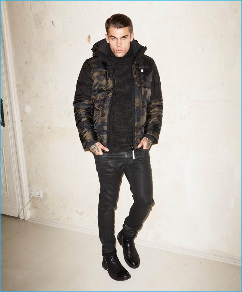 Stephen James rocks a camouflage G-Star Raw jacket with coated jeans for Theo Wormland's fall-winter 2016 campaign.