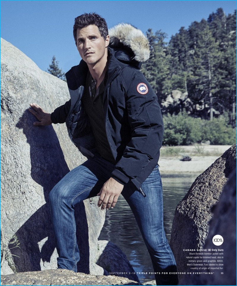 Ollie Edwards sports a black bomber jacket from Canada Goose for Bloomingdale's.