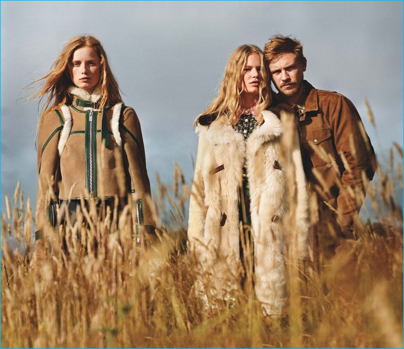 Wearing a Carhartt jacket, Boyd Holbrook joins models Rianne Von Rompaey and Anna Ewers for a Vogue spread.