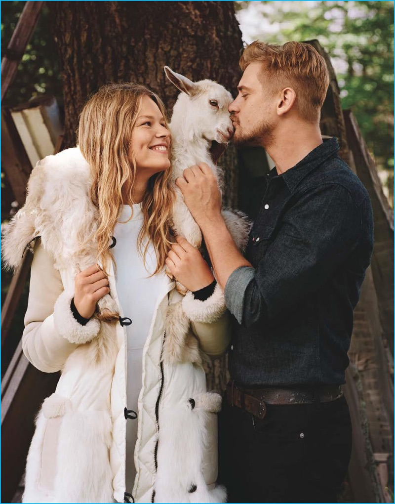 Modeling a Levi's shirt with Denim & Supply Ralph Lauren denim jeans, Boyd Holbrook lays a smooch on a goat for Vogue.