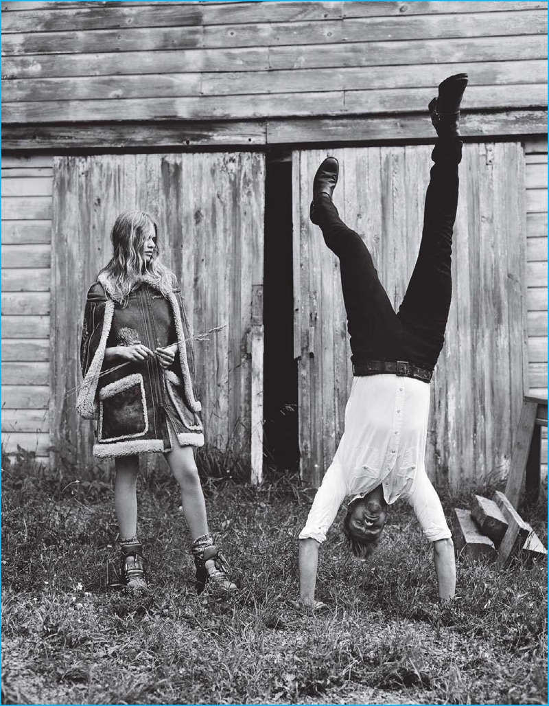 Pictured in a Stetson shirt with Levi's jeans and Frye boots, Boyd Holbrook masters a handstand for Vogue.