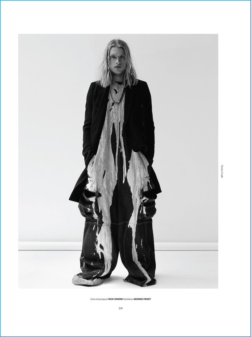 Model Carlton Ruth wears a coat and jumpsuit from Rick Owens with George Frost necklaces.