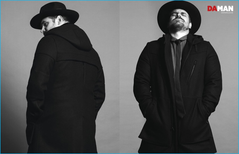 David Harbour wears a coat, shirt and tie from Robert James with a Worth & Worth hat.