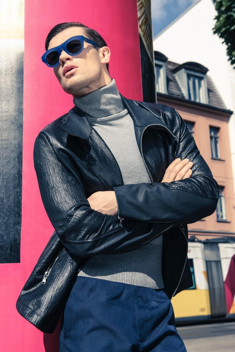 Eugen wears sunglasses Mykita, turtleneck Ivanman, leather jacket Siyah, and pants Keisuke Yoneda.