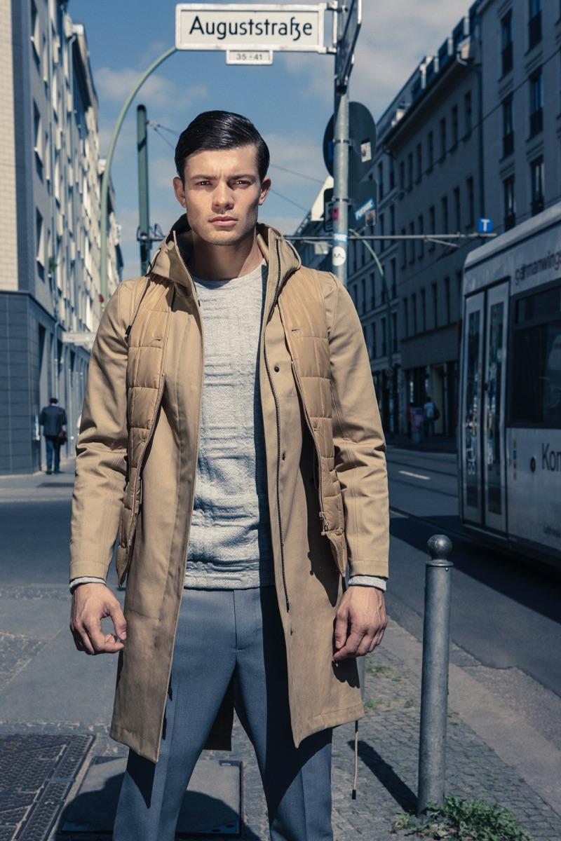 Eugen wears raincoat Stutterheim, trousers Ivanman, and sweater Kiomi.