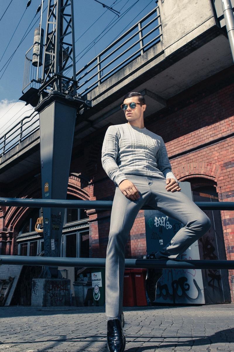 Eugen wears sunglasses IC! Berlin, sweater Kiomi, trousers Ivanman, and shoes J Fenestrier.
