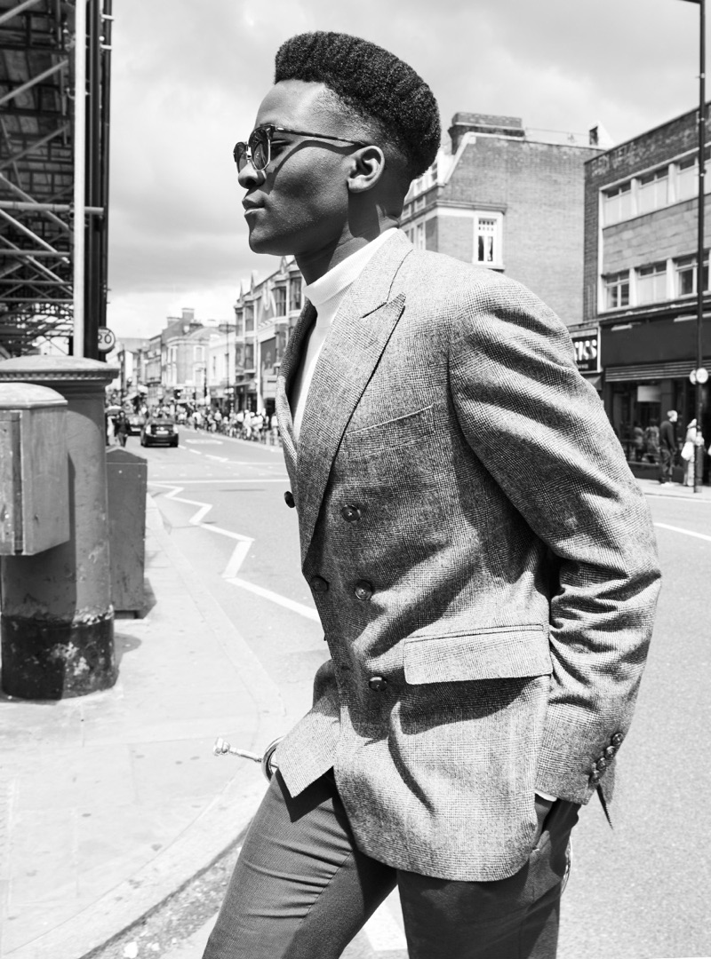 Rahim wears shirt Topman, sunglasses Ray-Ban, shoes Base London, jacket and trousers Holland Esquire.