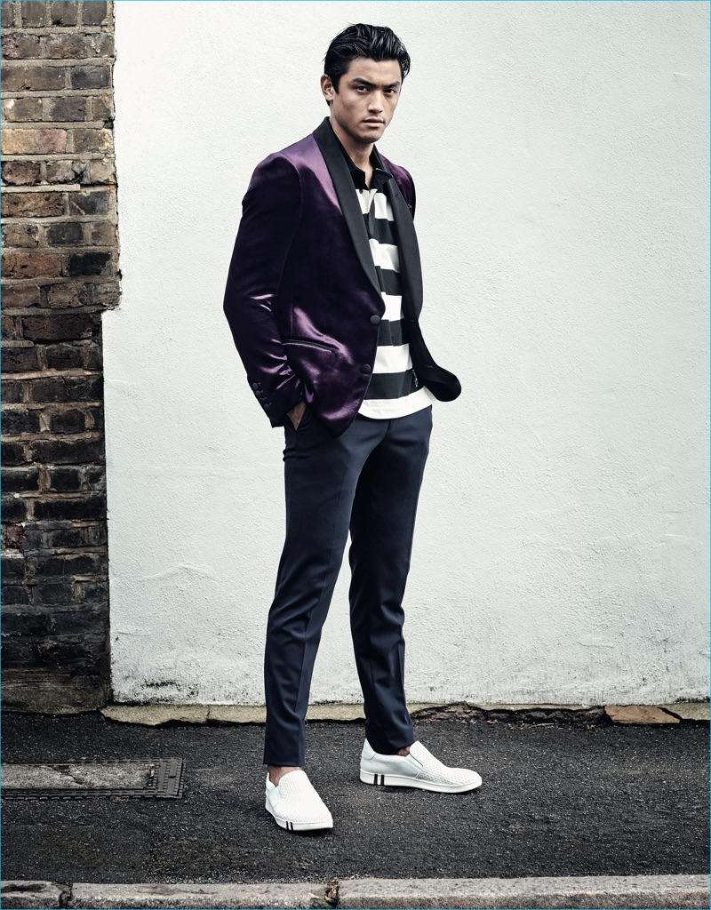 Luiz Piva models a purple velvet blazer and striped polo shirt from Bally for GQ France.