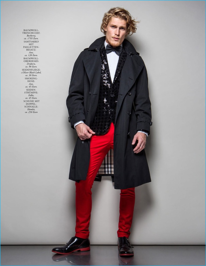 Harry Goodwins dons a trench coat from Burberry with a Drykorn shirt, s.Oliver Black Label bow-tie, Hamlet shoes, as well as an ASOS smoking jacket and red pants.