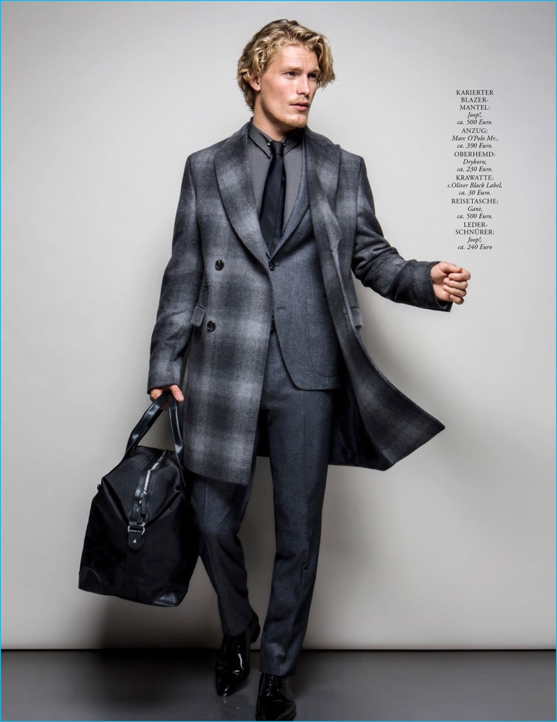 Dashing in a Joop! coat, Harry Goodwins wears a Marc O'Polo suit, Drykorn shirt, s.Oliver Black Label tie, Gant bag, and Joop! shoes.
