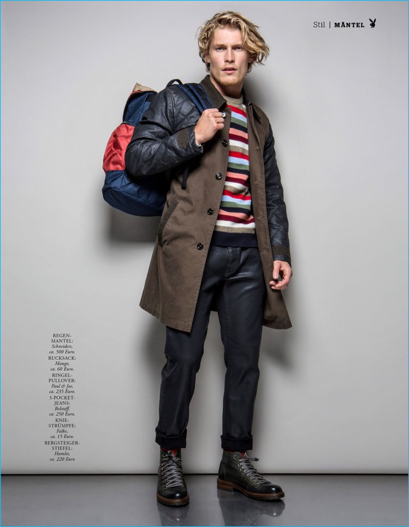 Appearing in an editorial for Playboy Germany, Harry Goodwins sports a Schneider coat, Mango backpack, Paul & Joe sweater, Belstaff jeans, and Hamlet boots.