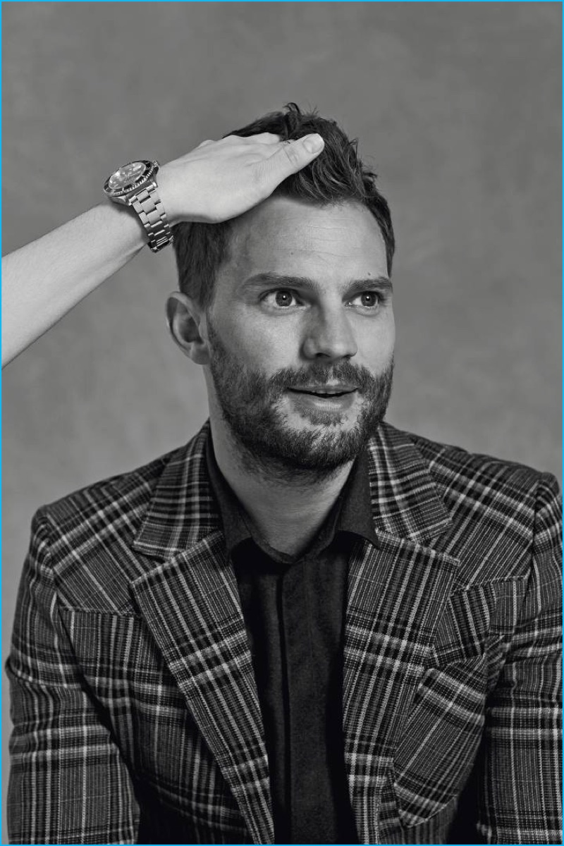 Appearing in a photo shoot for Icon El País, Jamie Dornan dons a check Prada jacket with an Emporio Armani shirt.