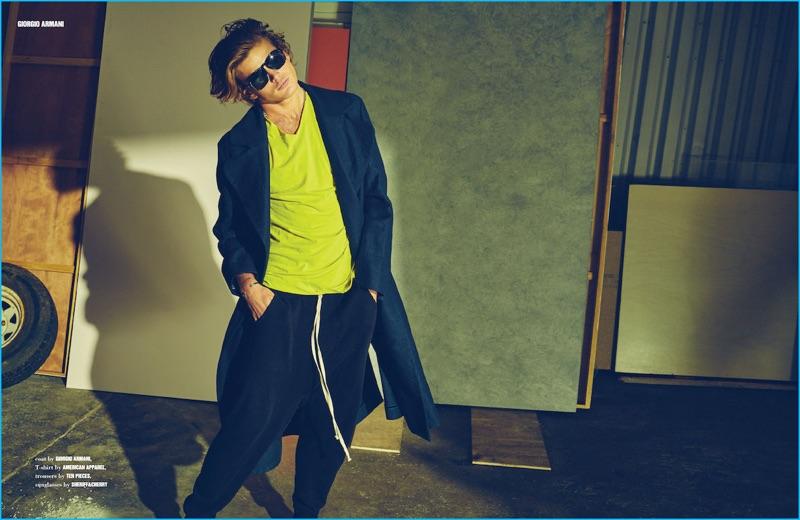 Channeling an effortless cool, Jordan Barrett models a long Giorgio Armani coat for 10 Men Australia.