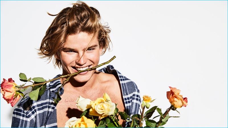 Australian model Jordan Barrett sports a check shirt from Norse Projects.