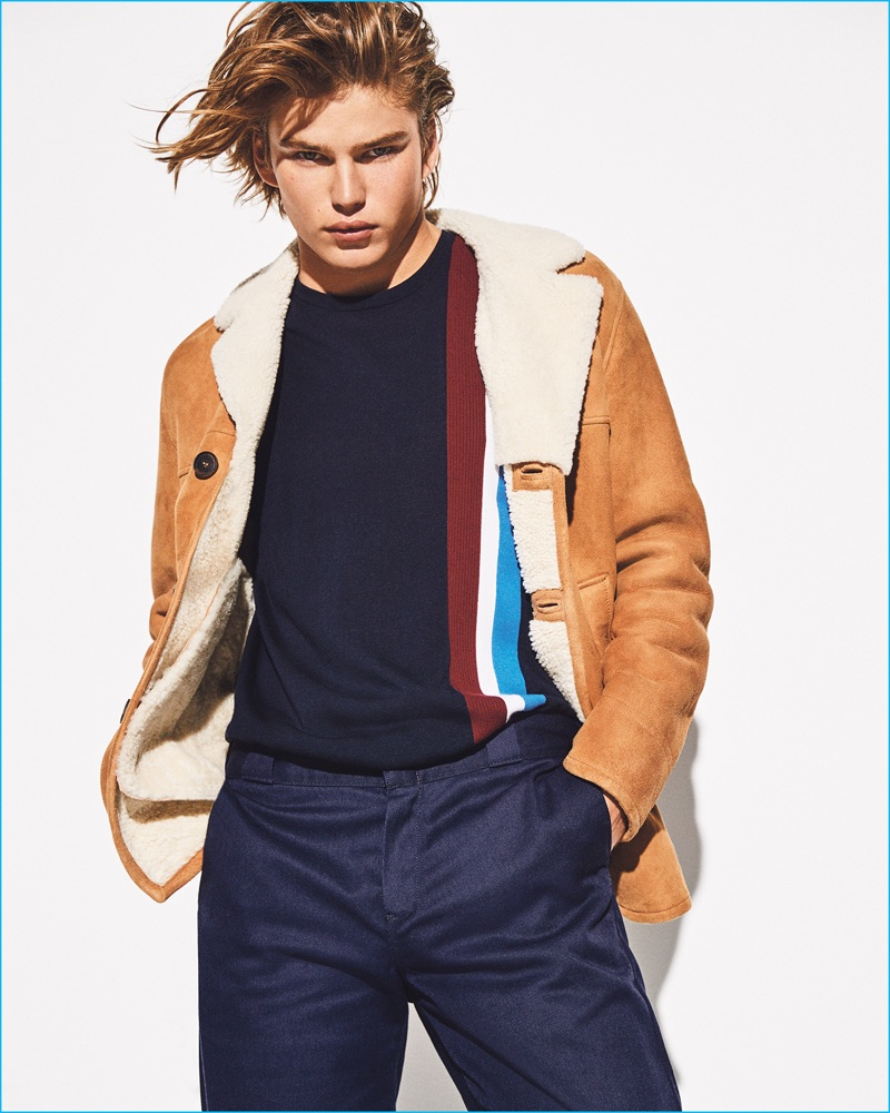 Appearing in a photo shoot for Sunday Times Style magazine, Jordan Barrett wears a Pringle of Scotland sweater. Jordan also sports a Gant shearling jacket and Dickies pants.