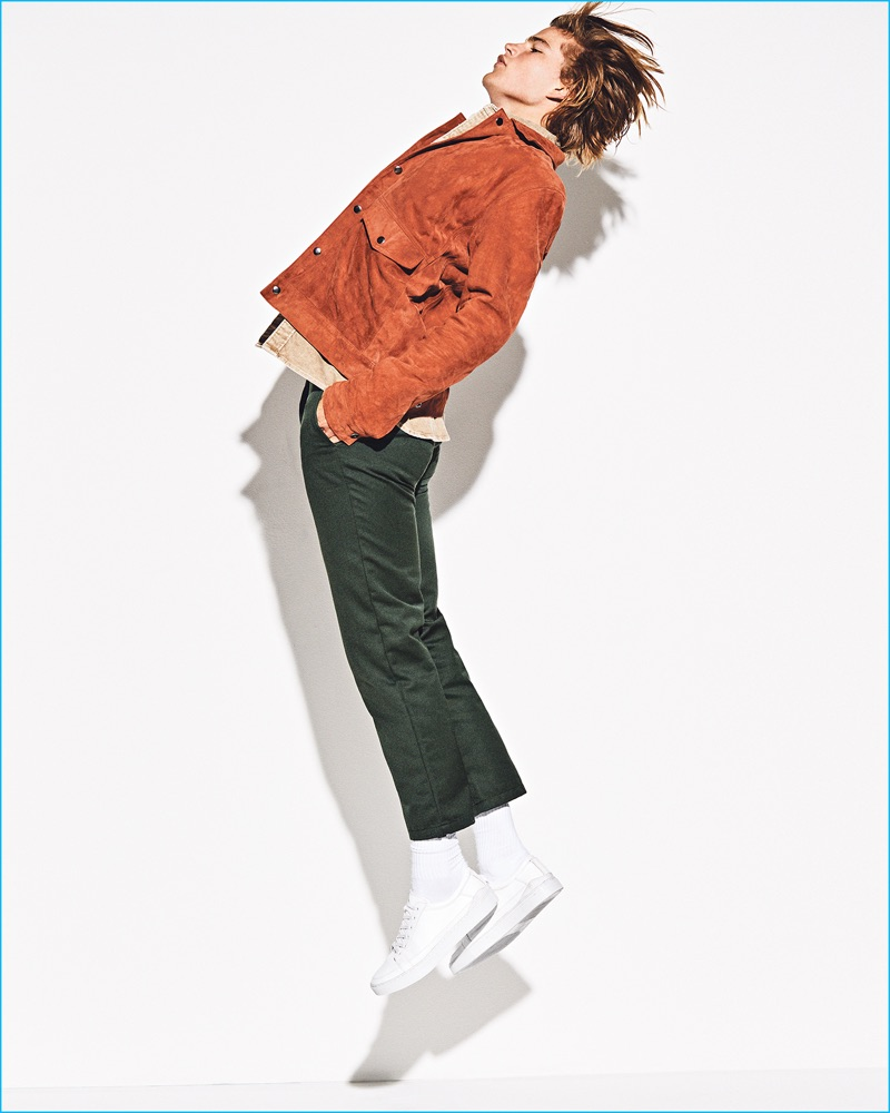 Autumnal tones are front and center as Jordan Barrett wears a red suede Topman jacket. The Australian model also rocks a Levi's t-shirt, Carhartt chinos, and Axel Arigato sneakers.
