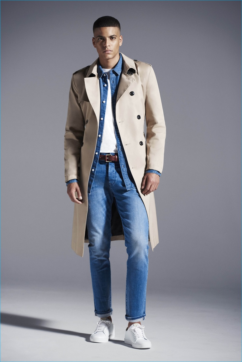 Zakaria Khiare doubles down on denim, completing his look with a River Island trench coat.