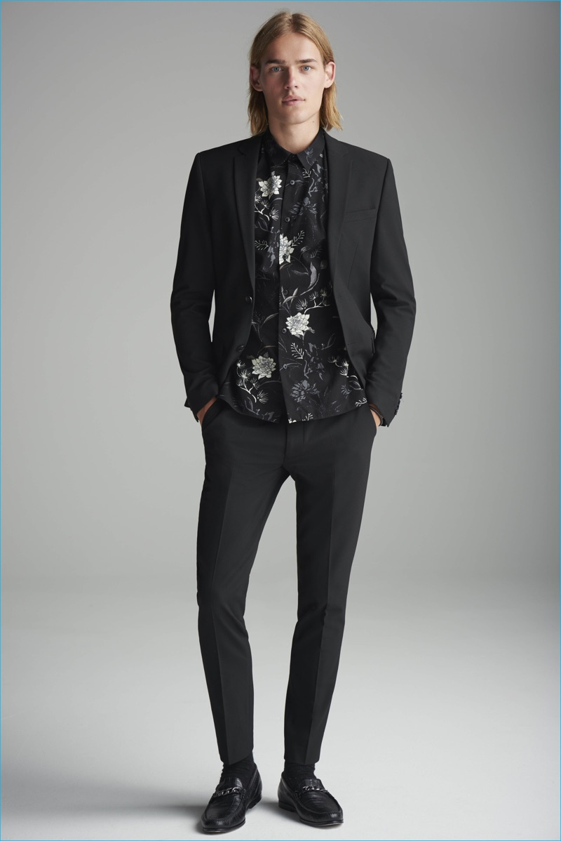 Ton Heukels dons a black suit with a floral print shirt from River Island.