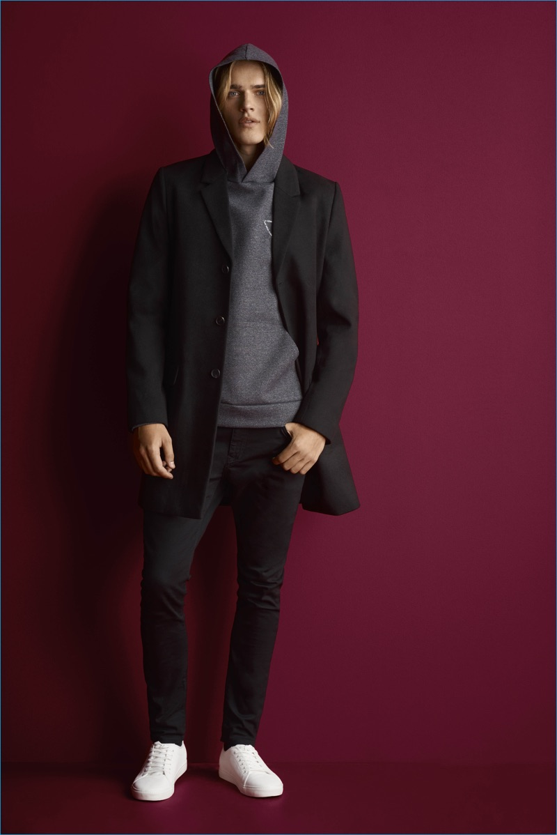 River Island goes sporty with a tailored coat and hooded sweatshirt, paired with skinny jeans.