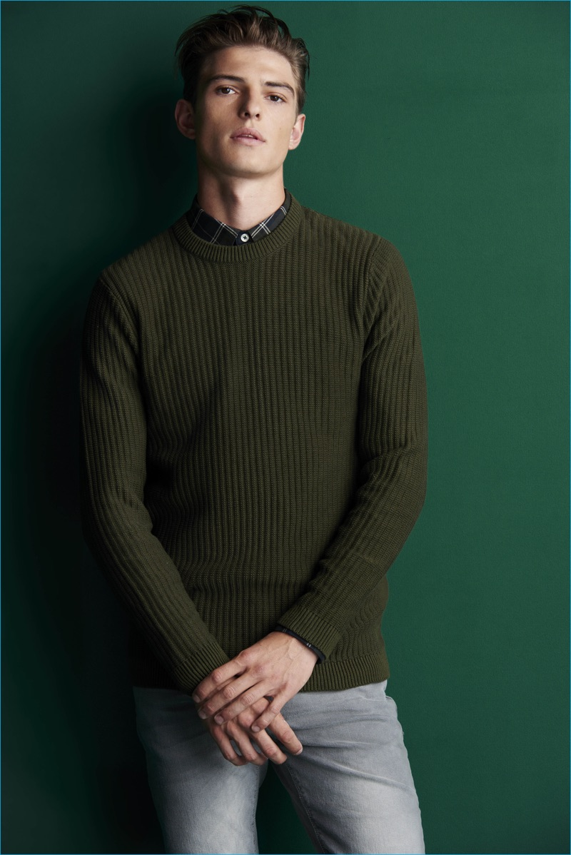 Playing it smart, Guerrino Santulliana wears a green sweater with a fitted button-down shirt from River Island.