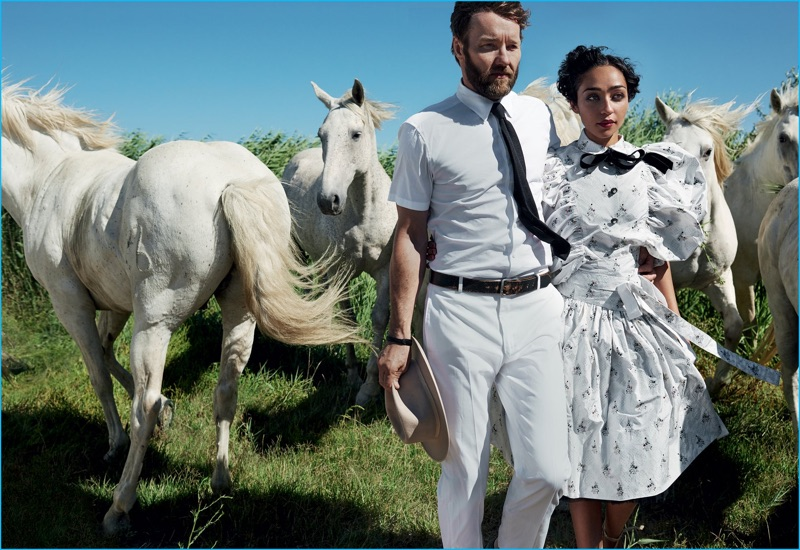 Donning white fashions, Loving co-stars Joel Edgerton and Ruth Negga pose with horses for Vogue.