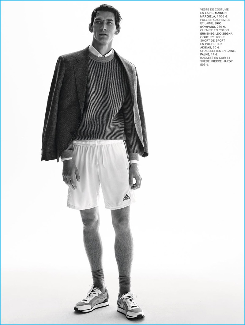 Thibaud Charon models a collision of styles with a Maison Margiela blazer, Eric Bompard sweater, Ermenegildo Zegna Couture shirt, Adidas shorts, and Pierre Hardy sneakers.