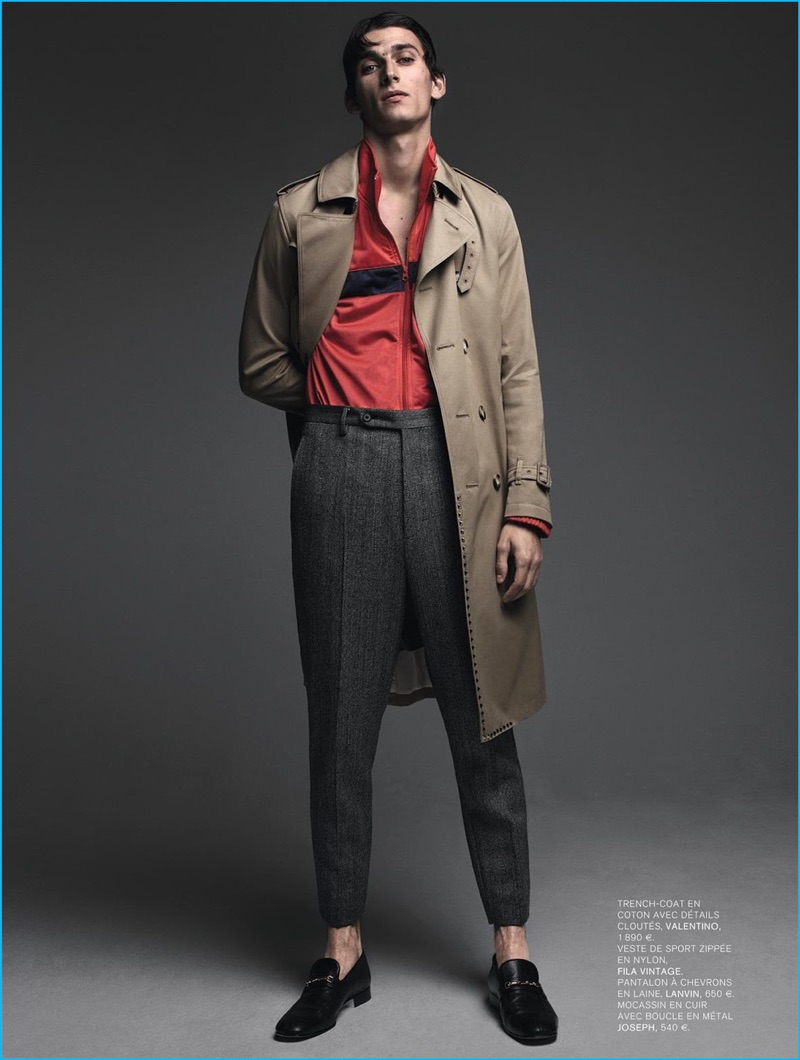 Standing tall, Thibaud Charon models a Valentino trench coat with a vintage Fila track jacket, Lanvin trousers, and Joseph dress shoes.
