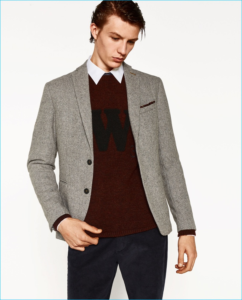 Finnlay Davis wears a blazer with elbow patches from Zara Man's College League collection.