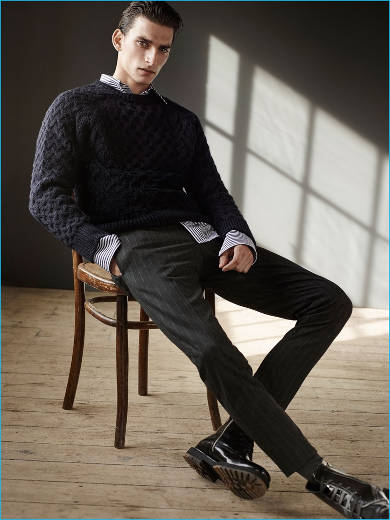 b2e905aa Thibaud Charon embraces a smart look from Zara Man, wearing a fisherman  sweater with pinstripe
