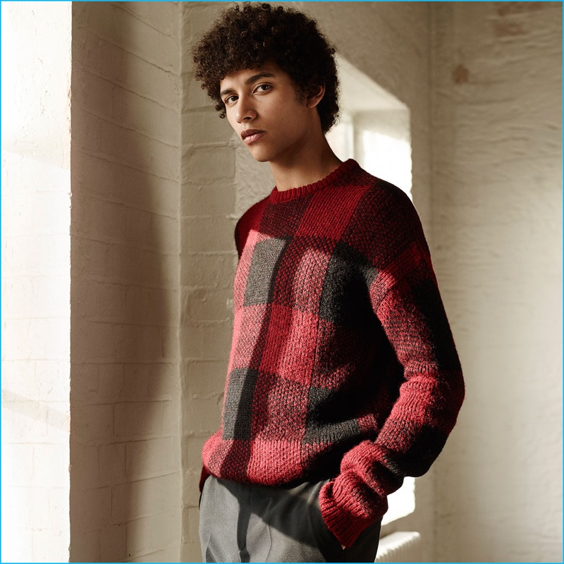 02595d2c Jackson Hale shines in a black and red buffalo check sweater with grey  trousers from Zara