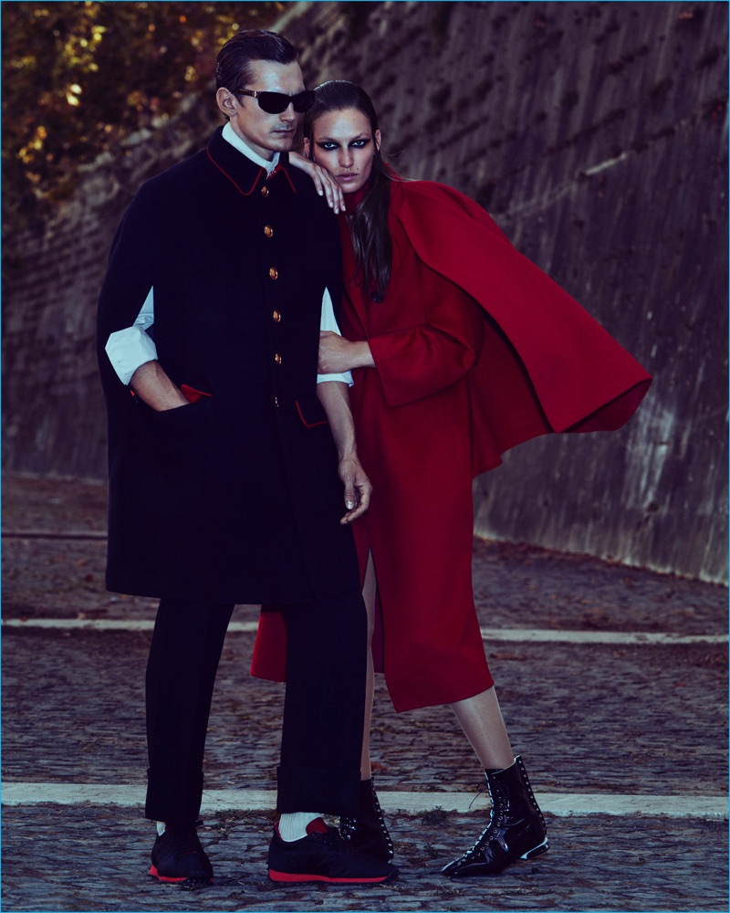 Models Anthon Wellsjo and Smith Vanders couple up for How to Spend It. Anthon wears a Burberry cape, trousers and sneakers with a Andreas Kronthaler for Vivienne Westwood shirt and Linda Farrow x Ann Demeulemeester sunglasses.