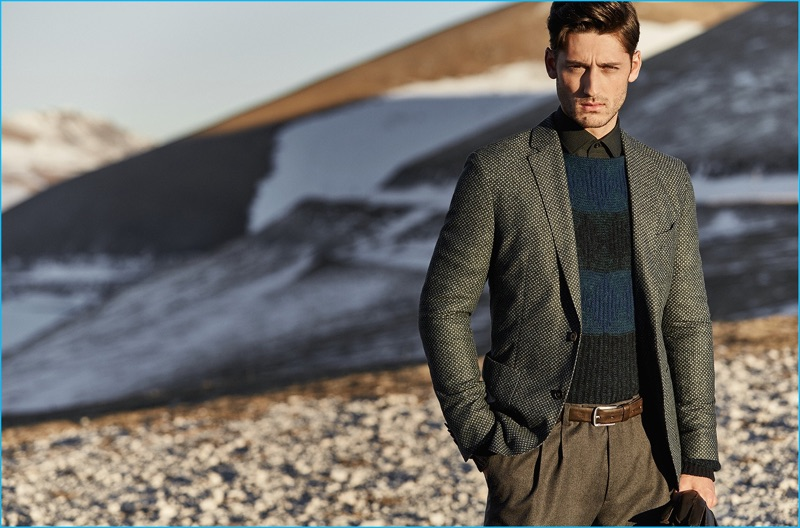 A smart vision, Carlos Ferra sports a striped sweater and sport coat with pleated trousers from Baldessarini.