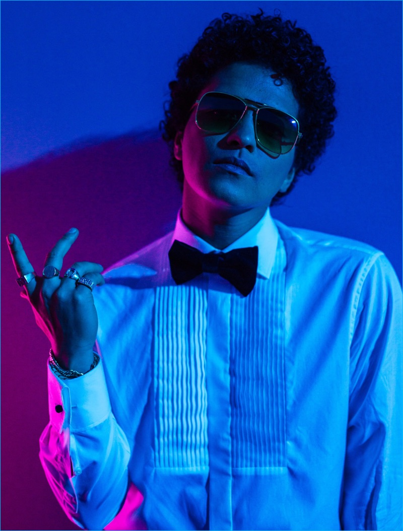 Rocking sunglasses, Bruno Mars sports a tuxedo shirt and bow-tie as he poses behind the scenes of the Victoria's Secret fashion show.
