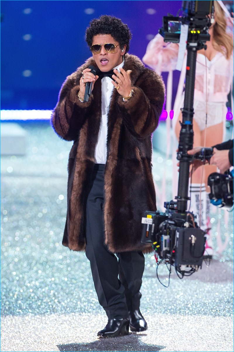 Singer Bruno Mars performs in a Tommy Hilfiger faux fur coat during the 2016 Victoria's Secret fashion show at Le Grand Palais in Paris.