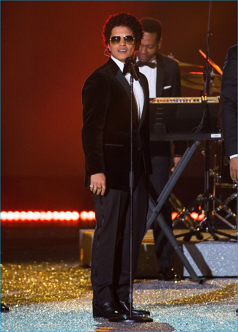 Bruno Mars takes to the runway to perform in a Tommy Hilfiger tuxedo for the 2016 Victoria's Secret fashion runway show.