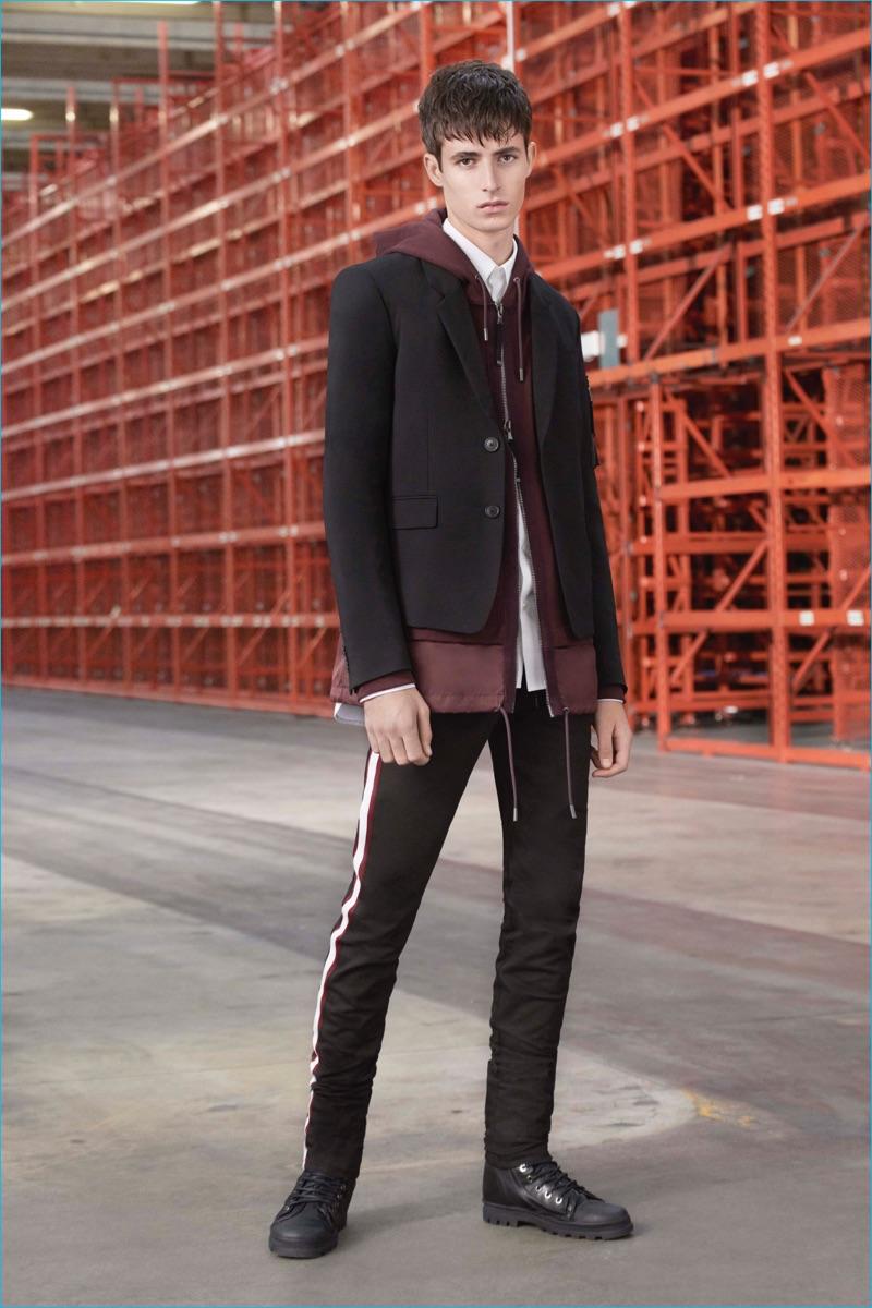 Diesel Black Gold goes sporty, juxtaposing a trim sport coat with a full-zip hooded sweatshirt.