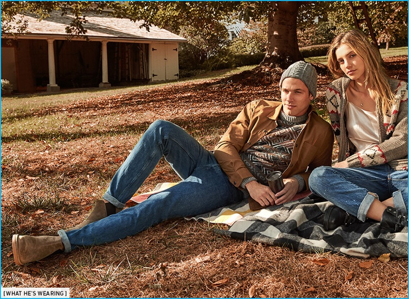 Kacey Carrig wears A.P.C. low standard jeans, Vince suede Chelsea boots, and Schnayderman's waxed cotton overshirt with a knit beanie and sweater from Howlin'.
