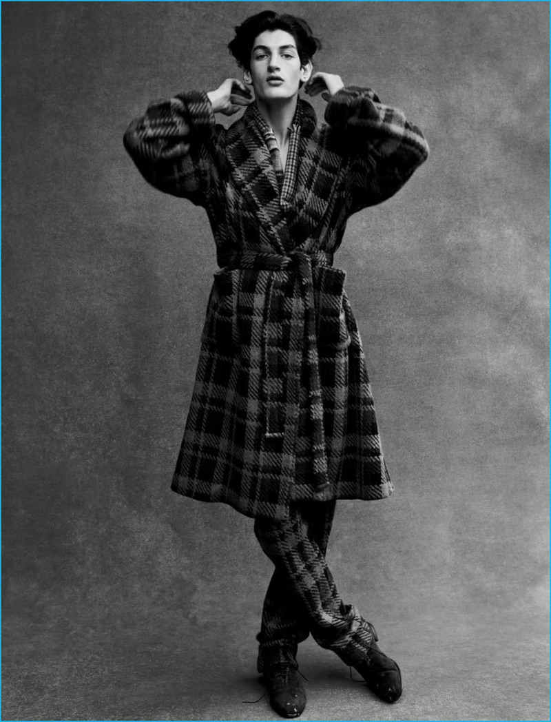 Aaron Shandel wears a plaid coat and trousers by Fendi with a Lanvin scarf and Salvatore Ferragamo shoes.