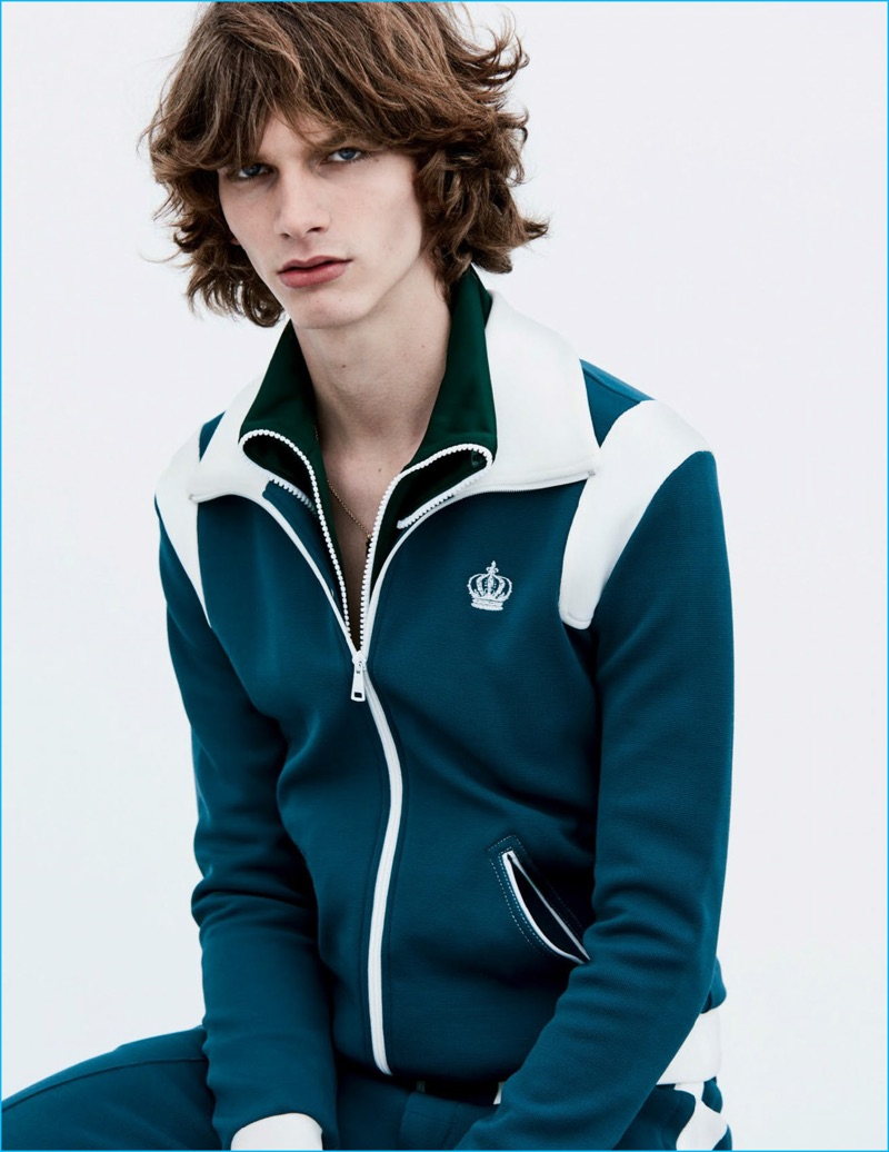 Erik van Gils is front and center in a Dolce & Gabbana track jacket and pants with a Burberry necklace.