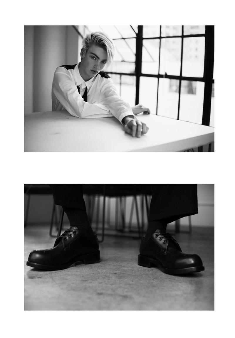 Fresh face Elijah wears a Comme des Garçons shirt, Societe Anonyme trousers, and Alexander McQueen dress shoes.