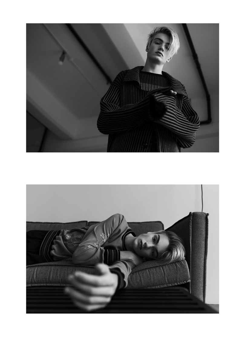 Top: Elijah wears a knit trench and sweater by Opening Ceremony. Bottom: Elijah sports a Vivienne Westwood top with Rick Owens pants.