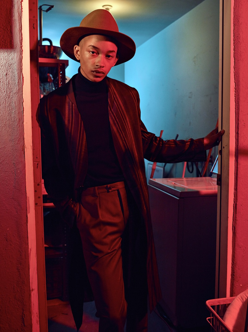 Embodying a cool image, Andre Lamone models a jacket by The Kooples with a Hugo Boss turtleneck, Jeffrey Rüdes pants, and a Gladys Tamez Millinery hat.