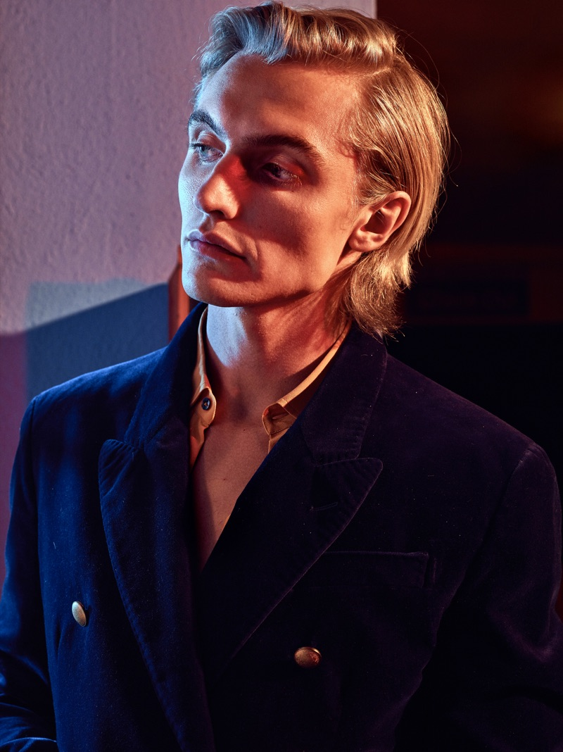 Model Hart Denton dons a double-breasted Jeffrey Rüdes blazer with a smart shirt.