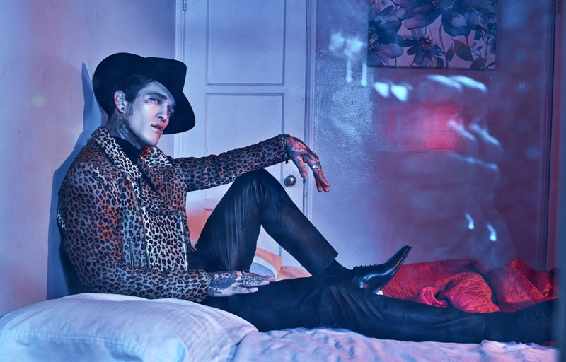 Rocking a rebellious look, Jimmy Q wears a Sav Noir leopard print jacket with an Ashton Michael Shirt and Gladys Tamez Millinery hat. The American model also models pants and shoes from The Kooples.