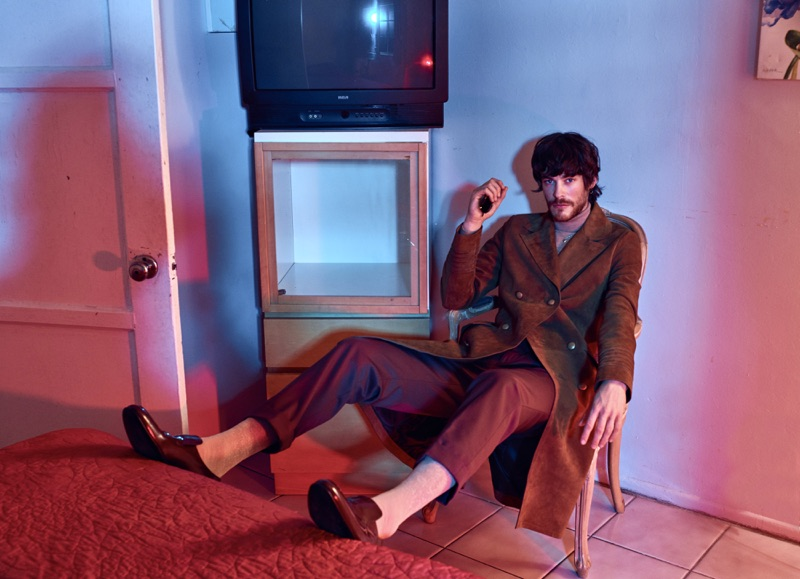 Jonas Kesseler makes a brown statement in Jeffrey Rüdes double-breasted coat with tailored pants and shoes. The German model also sports a Hugo Boss turtleneck.
