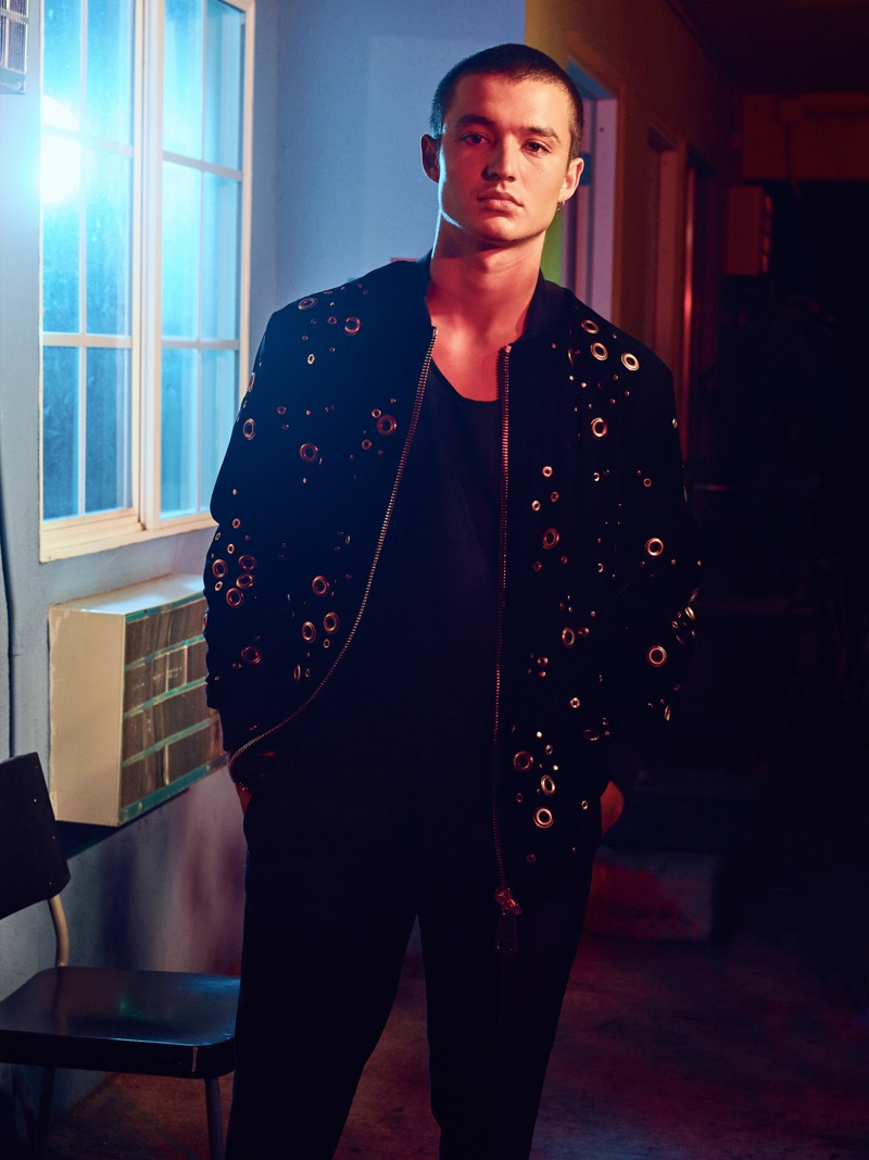 Kaleb Ressler tackles dark layers in an Ashton Michael bomber jacket with a tank and pants by The Kooples.