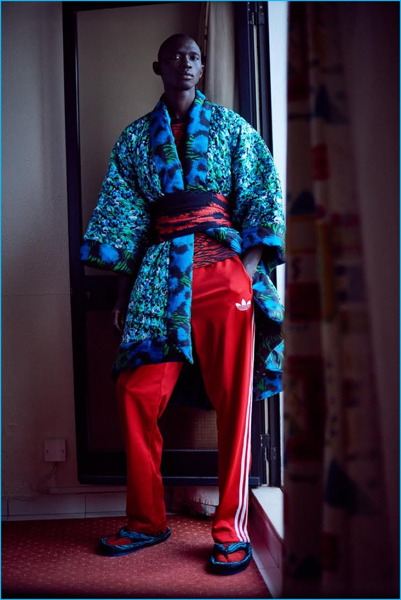 Leading model Fernando Cabral sports a Kenzo x H&M patterned robe with Adidas track pants.