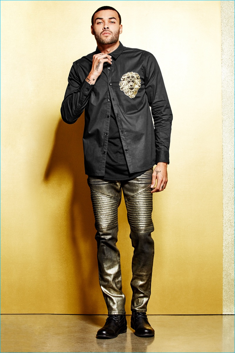 Don Benjamin wears a lion adorned shirt with gold skinny moto jeans from G by GUESS' Empire collection.